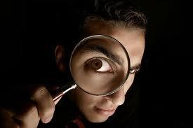 Man_with_magnifying_glass