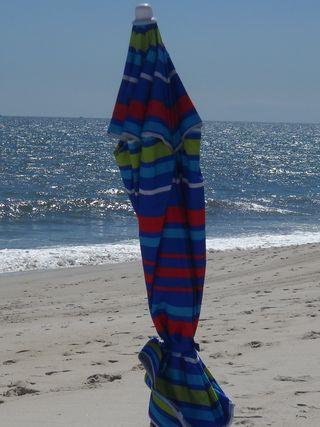 Folded_beach_umbrella_fireisland_pines