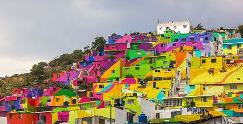 Artists-breathe-new-life-into-a-community-by-painting-all-200-of-their-houses51-650x332
