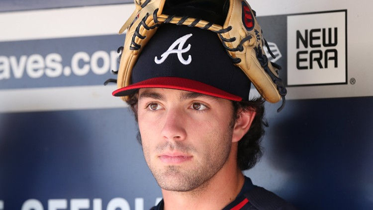 Dansby with catchers mitt on head