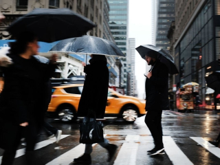 Cold-rain-and-wind-bear-down-on-new-york-city-commuters-20190513081420-84079800