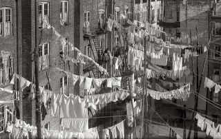 Laundry_hanging_out_of_tenement_building_windows